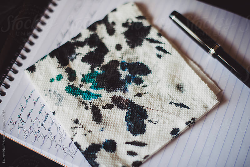 Ink blots on napkin, fountain pen and notepad by Lauren Naefe for Stocksy United