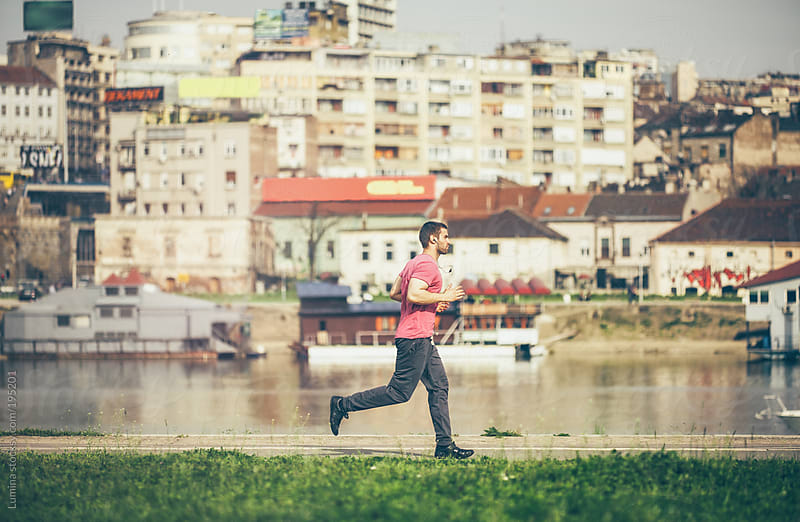Man Running by the River by Lumina for Stocksy United
