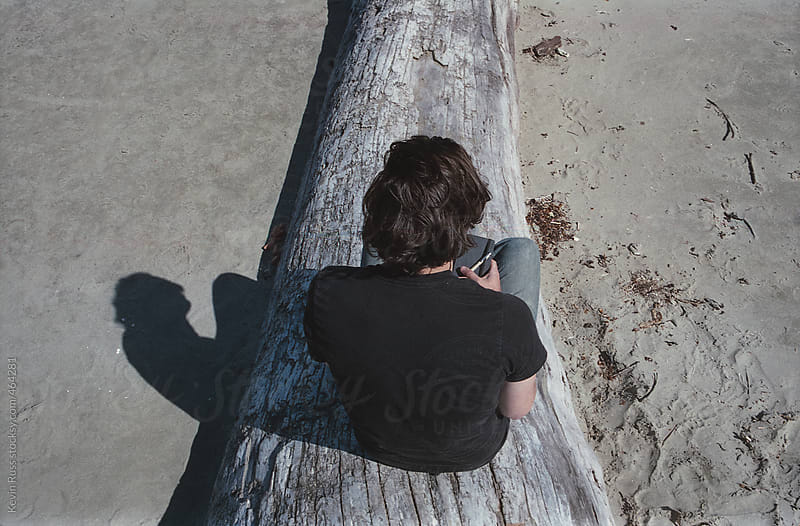 Man Sitting on a Log with a Journal by Kevin Russ for Stocksy United