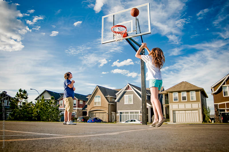 teens playing basketball by Tomas Kraus for Stocksy United