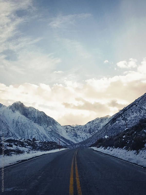 Winter Landscape on an Empty Road  by MEGHAN PINSONNEAULT for Stocksy United