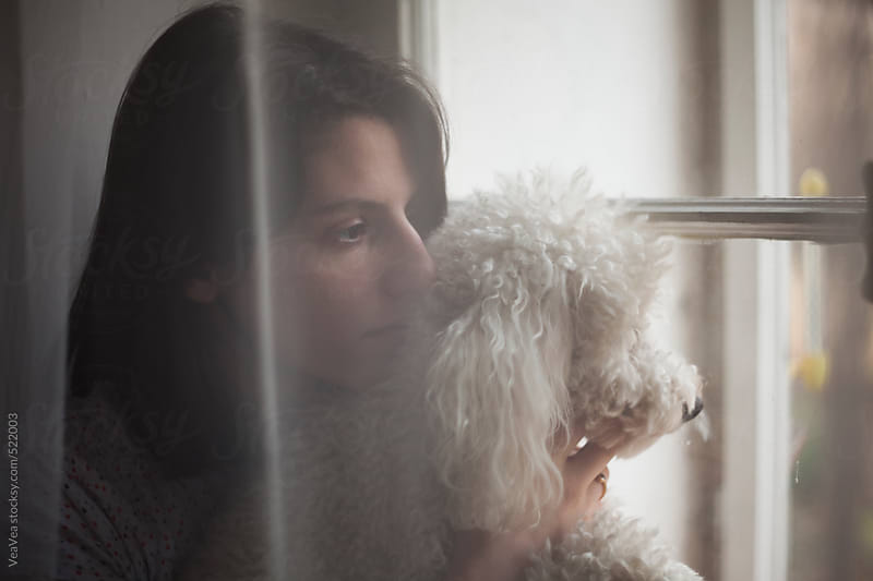 Portrait of a beautiful woman with her white poodle  by VeaVea for Stocksy United