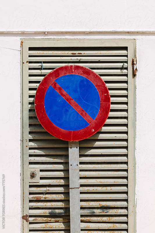 No Parking Sign on a Metallic Gate by VICTOR TORRES for Stocksy United