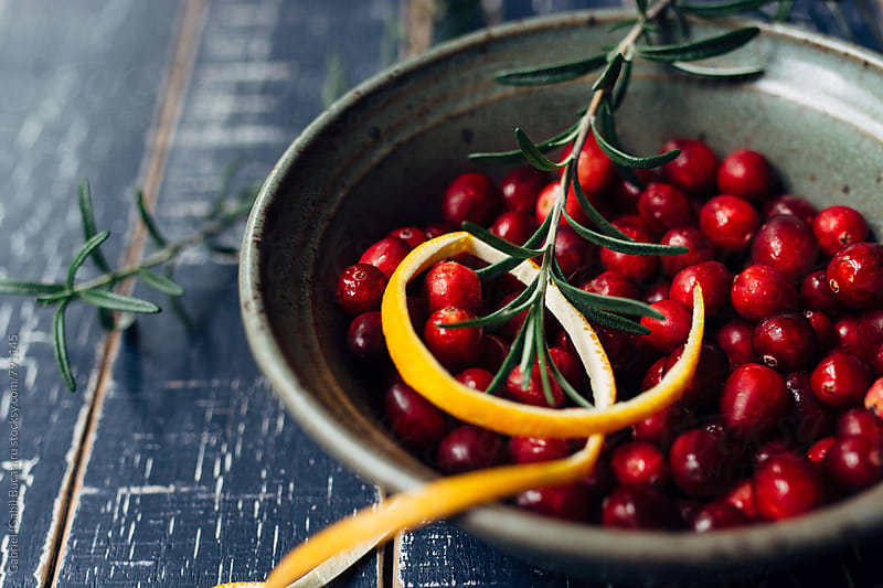Cranberry bowl with orange peel and rosemary by Gabriel (Gabi) Bucataru for Stocksy United