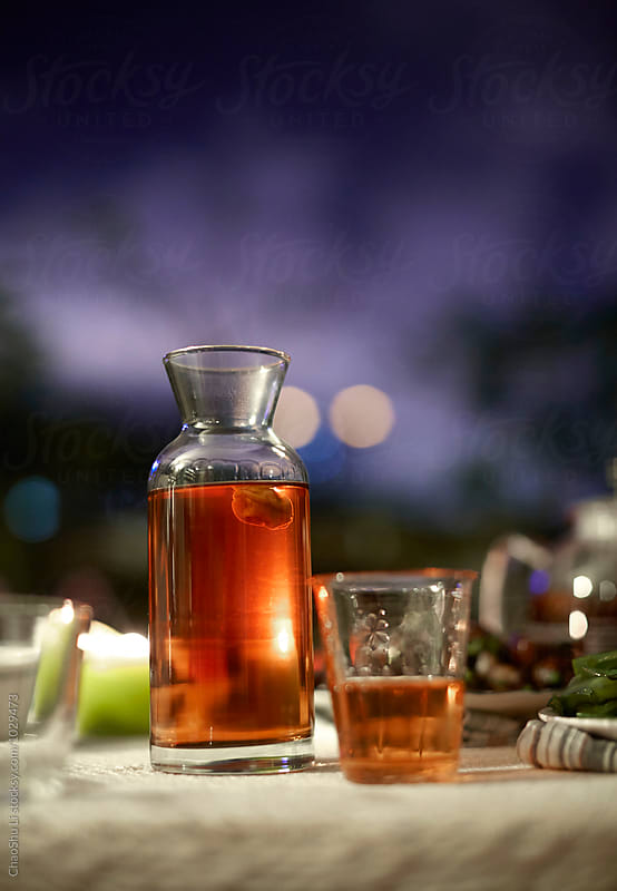 Plum wine on the table, early evening by ChaoShu Li for Stocksy United