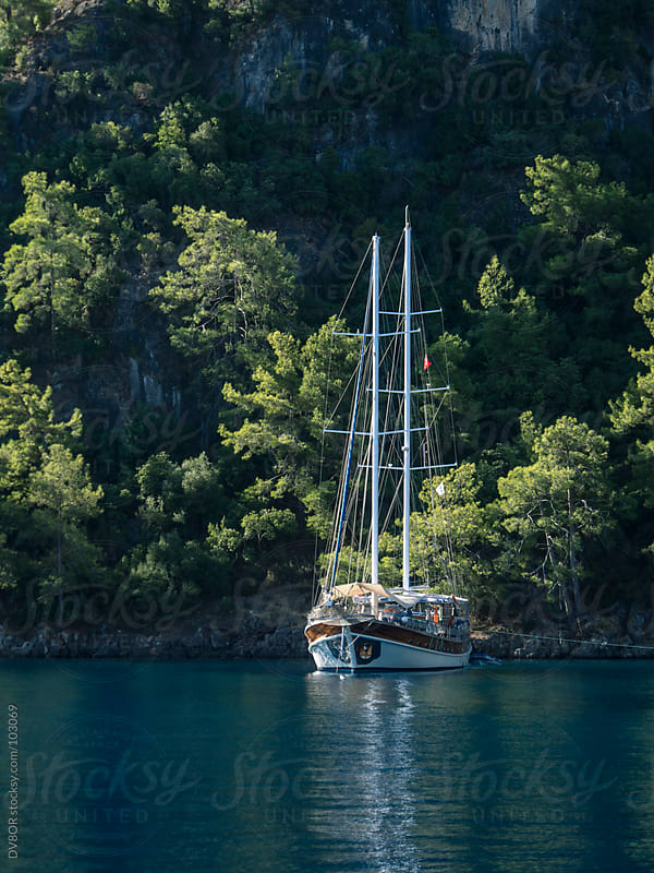 Traditional Turkish Gulet anchored in a bay by DV8OR for Stocksy United