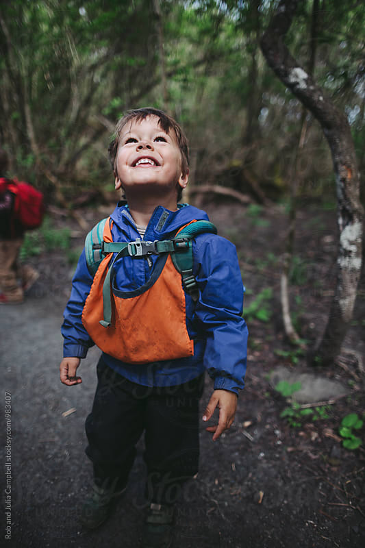Young caucasian boy on walking trail at nature preschool by Rob and Julia Campbell for Stocksy United