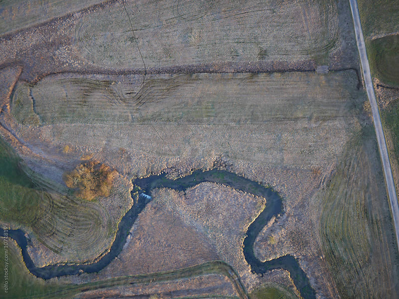 Textured landscape with curve river from above by rolfo for Stocksy United