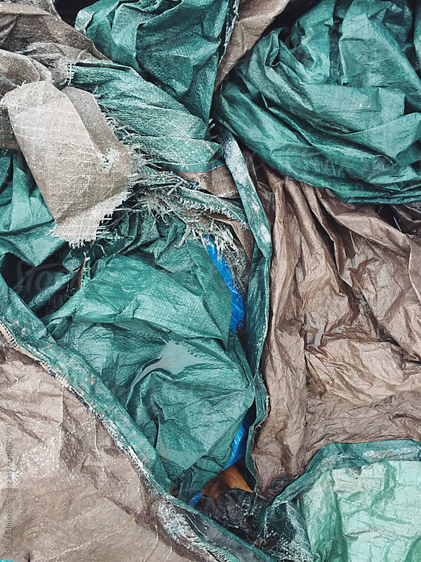 Pile of discarded industrial tarps by Paul Edmondson for Stocksy United