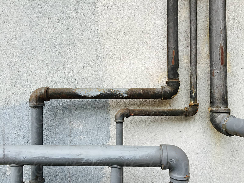 Close up of utility pipes by Paul Edmondson for Stocksy United