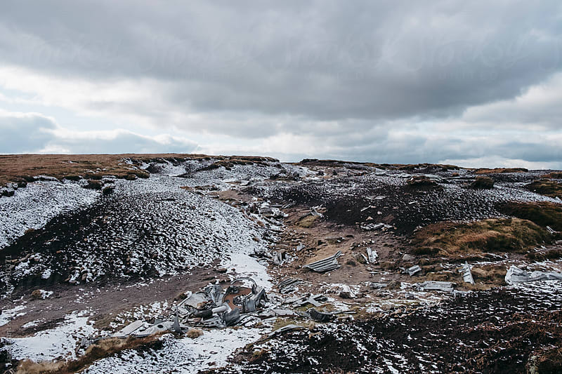 Wartime B-29 Superfortress plane wreckage on the snow covered moorland of Bleaklow, Derbyshire, UK. by Liam Grant for Stocksy United