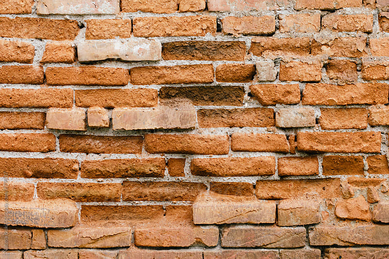 Orange brick wall background by Natasa Kukic for Stocksy United