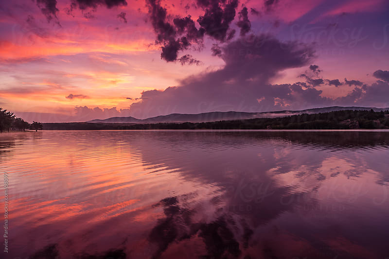 beautiful sunset on the lake by Javier Pardina for Stocksy United