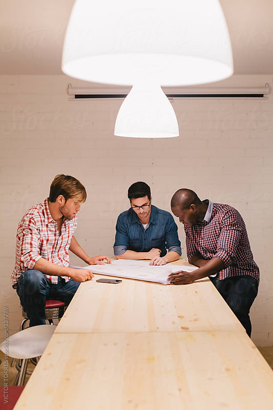 Architects and engineers working at the Office by VICTOR TORRES for Stocksy United