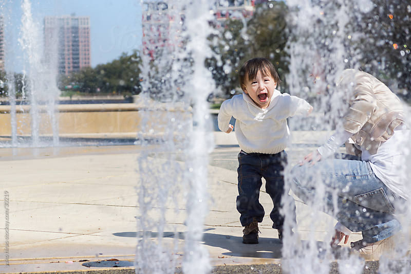 Surprised little boy with fountain by yuko hirao for Stocksy United