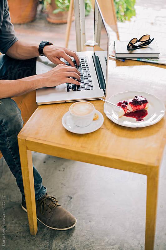 Man Working from a Modern Coffee Shop by Marija Savic for Stocksy United