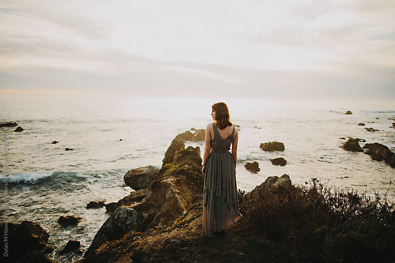 Pretty girl in dress on a sea cliff by Dylan M Howell Photography for Stocksy United