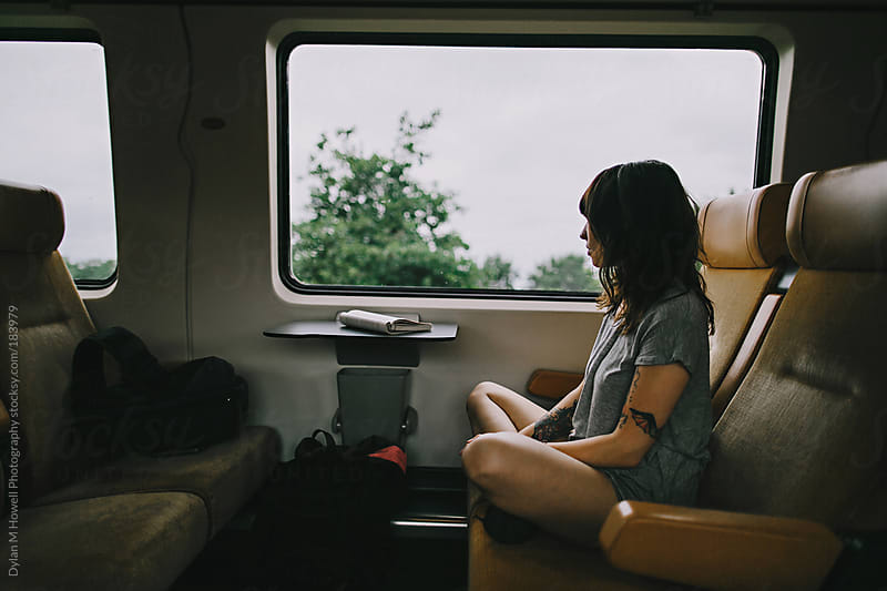 Girl on Train by Dylan M Howell Photography for Stocksy United