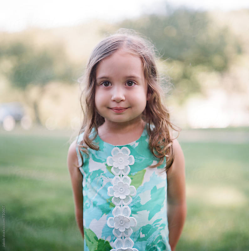 Portrait of a beautiful young girl in a dress by Jakob for Stocksy United