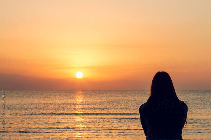 The silhouette of a young woman on the mediterranean coast at sunset  by Blue Collectors for Stocksy United