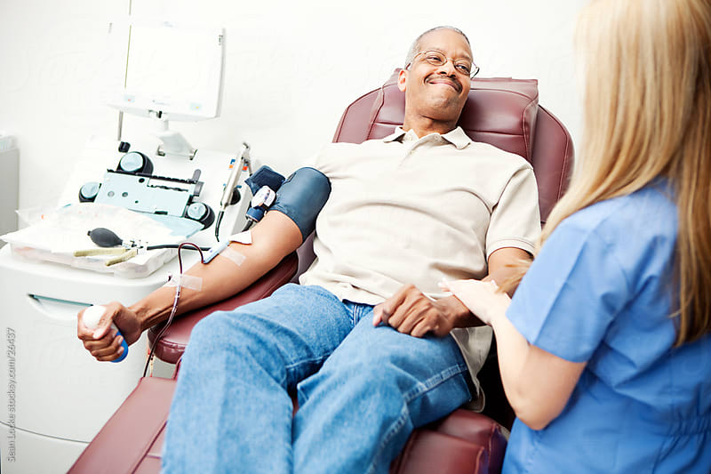 Blood Bank: Nurse Talks to Blood Donor by Sean Locke for Stocksy United