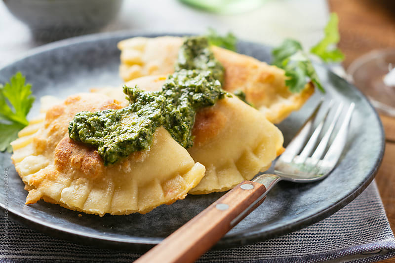 Squash pot-stickers with a cilantro sauce by Harald Walker for Stocksy United
