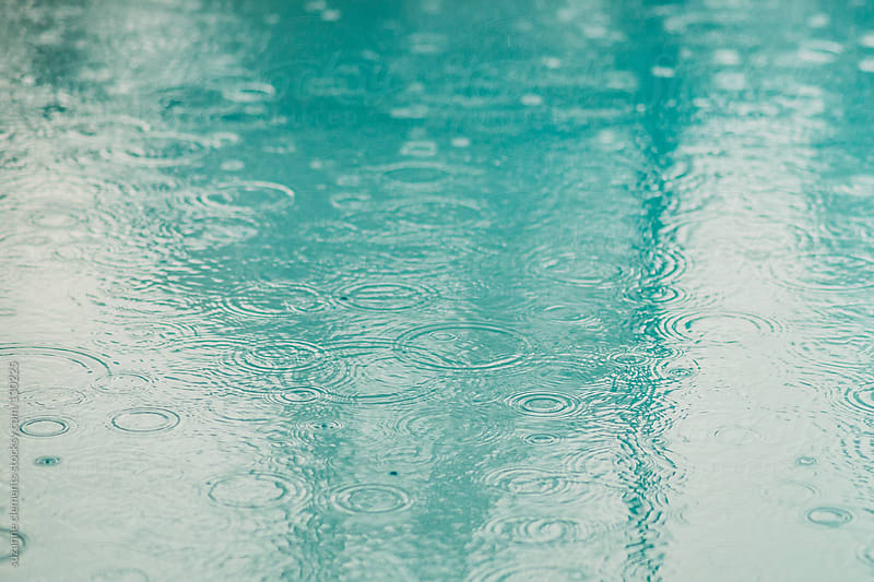 Sad Rainy Day No Chance for Swimming by suzanne clements for Stocksy United