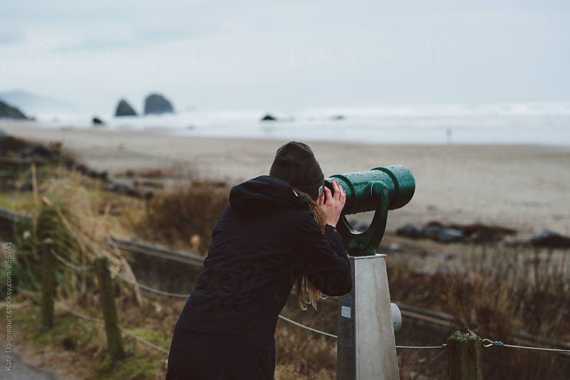 Young blonde woman using view finder at the beach in the winter. by Kate Daigneault for Stocksy United