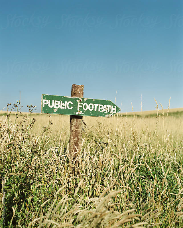 wooden public footpath sign by Suzi Marshall for Stocksy United