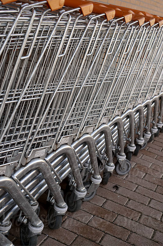 Shopping carts in a row by Marcel for Stocksy United