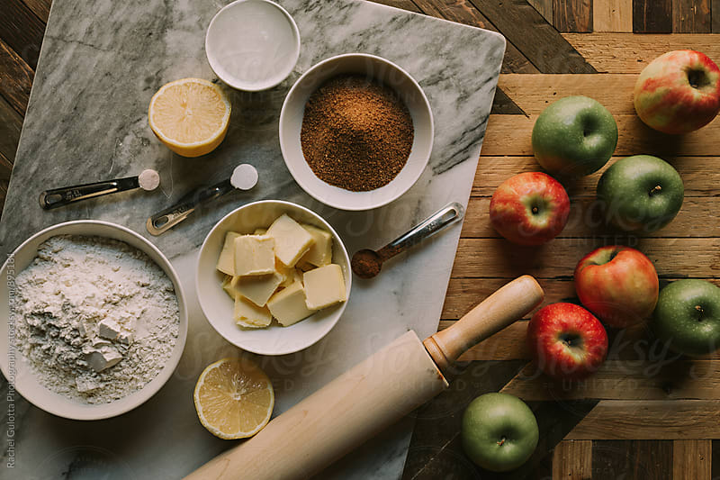 Apple Pie Baking Ingredients Laid out on a Table by Rachel Gulotta Photography for Stocksy United