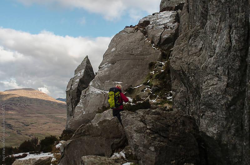 Female Mountaineering in Rocky Landscape by Neil Warburton for Stocksy United