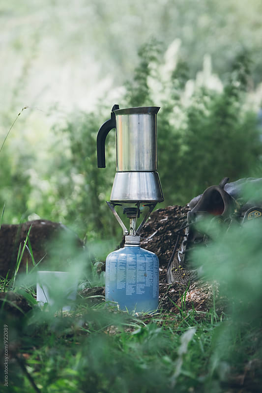 Coffee moka pot on a gas cooker in outdoors in a wilderness camp by Micky Wiswedel for Stocksy United