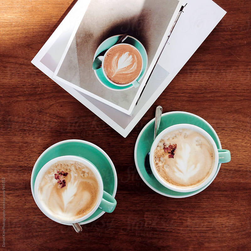 Lattes on table by Daniel Kim Photography for Stocksy United