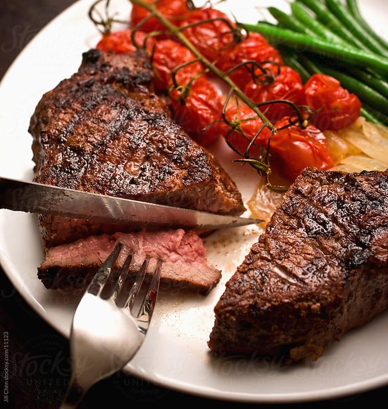Eating Steak by Jill Chen for Stocksy United