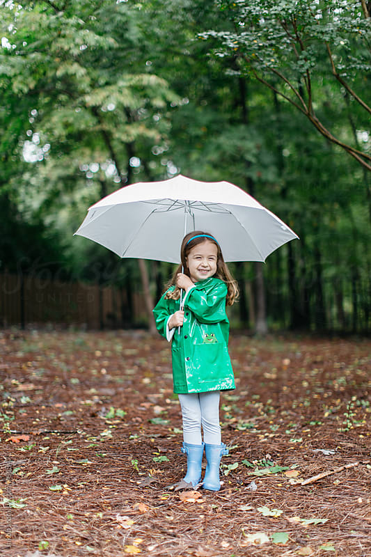 Cute young toddler with an umbrella and raincoat by Jakob for Stocksy United
