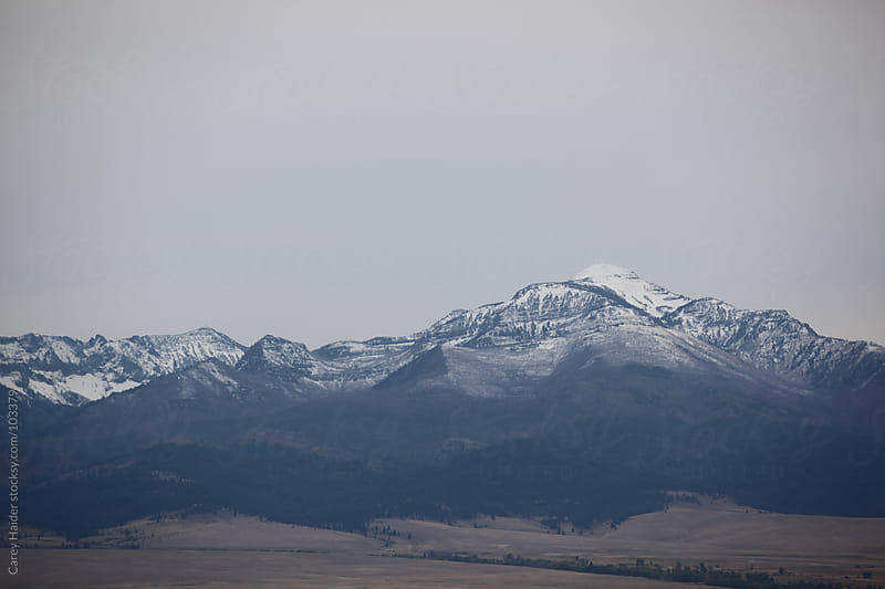 Snow Covered Mountains In The Distance by Carey Haider for Stocksy United