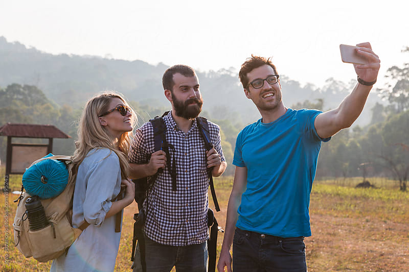 Friends taking a selfie together  by Jovo Jovanovic for Stocksy United