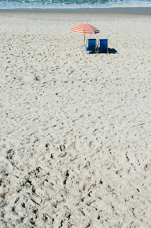 Two Beach Chairs and Striped Umbrella on Empty Beach by Julien L. Balmer for Stocksy United