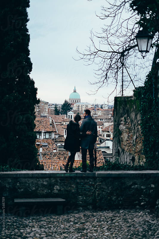 Back View of Young Couple Cuddling Visiting An Italian City by HEX. for Stocksy United