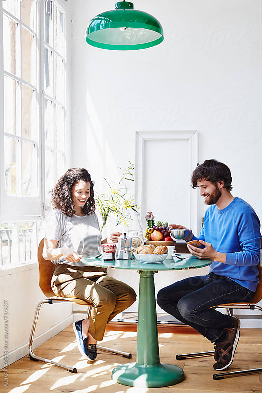 Happy Young Couple Having Breakfast At Home by ALTO IMAGES for Stocksy United