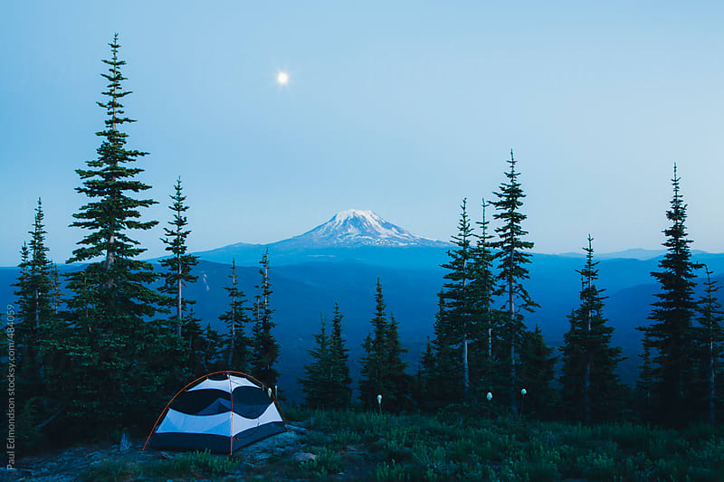 Camping tent in mountains at night with moon rise, Mt, Adams in distance by Paul Edmondson for Stocksy United