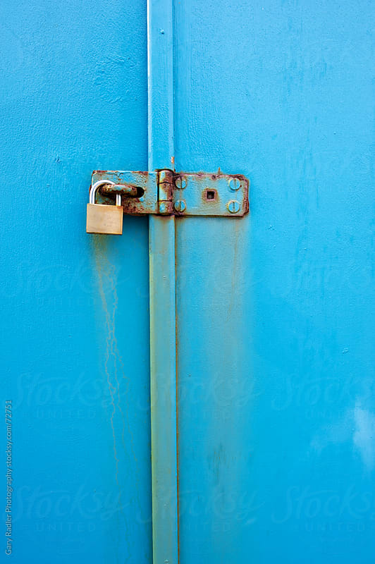 Padlock on a Blue Door by Gary Radler Photography for Stocksy United