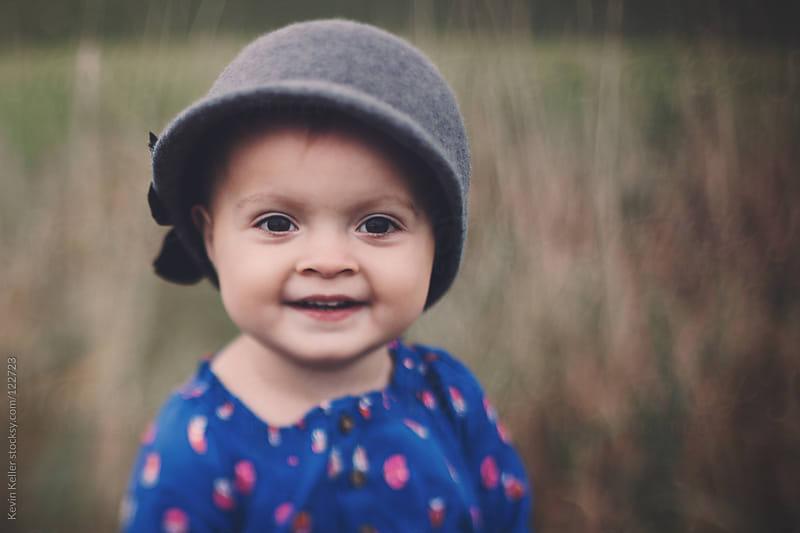 Smiling Toddler Girl Outside by Kevin Keller for Stocksy United