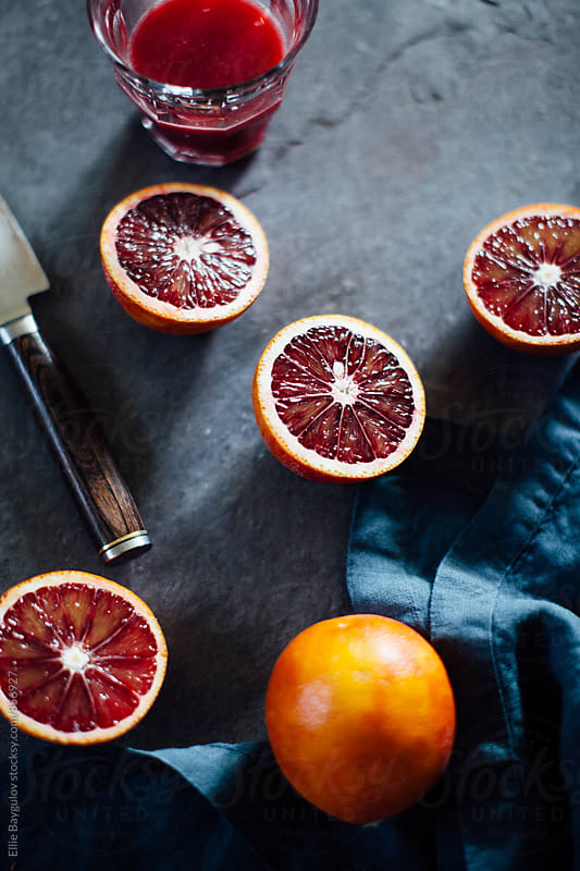Blood oranges by Ellie Baygulov for Stocksy United