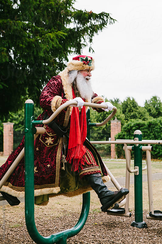 Santa Claus getting fit for christmas by kkgas for Stocksy United