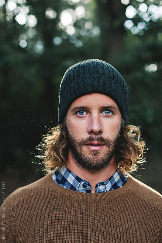 Portrait of a bearded man standing in the forest looking at camera by BONNINSTUDIO for Stocksy United