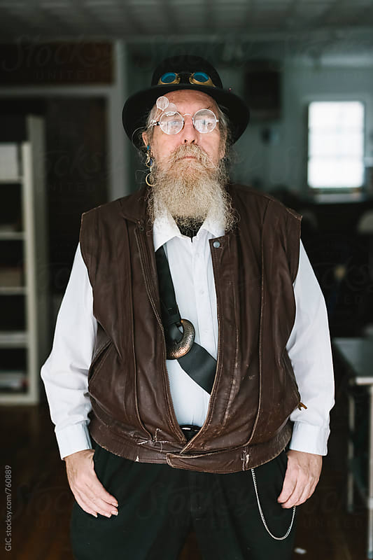 Stylish man with long beard and vintage glasses by WAVE for Stocksy United