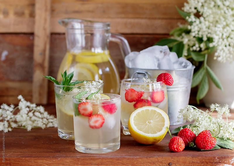 elderflower lemonade and strawberries by Viktorné Lupaneszku for Stocksy United