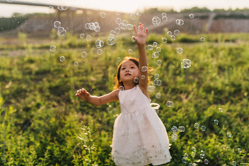 Cute little girl playing with bubble by MaaHoo Studio for Stocksy United
